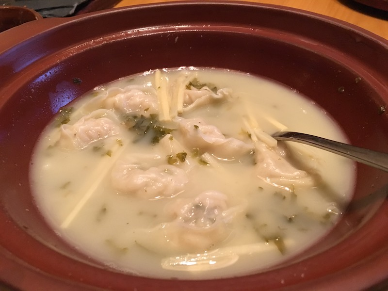 A shared fish soup dumpling pot