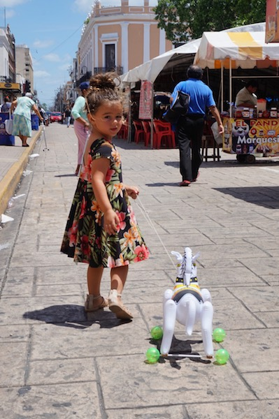 Walking through the plazas, shopping with her horsey.