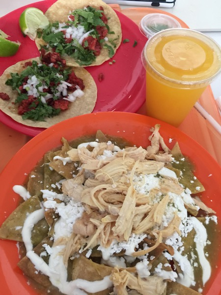 Chilaquiles, preferably with green tomatillo salsa and shredded chicken
